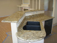Venetian Gold Granite With Black Granite Composite Sink and Custom Rounded End-Cap